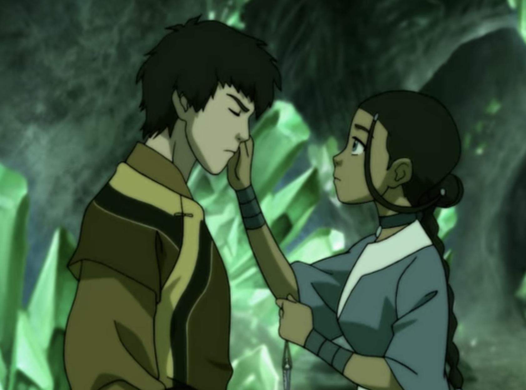 Katara touching the side of Zuko's face.