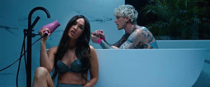 "Megan Fox puts Machine Gun Kelly in the bath in  his ""Bloody Valentine"" music video"