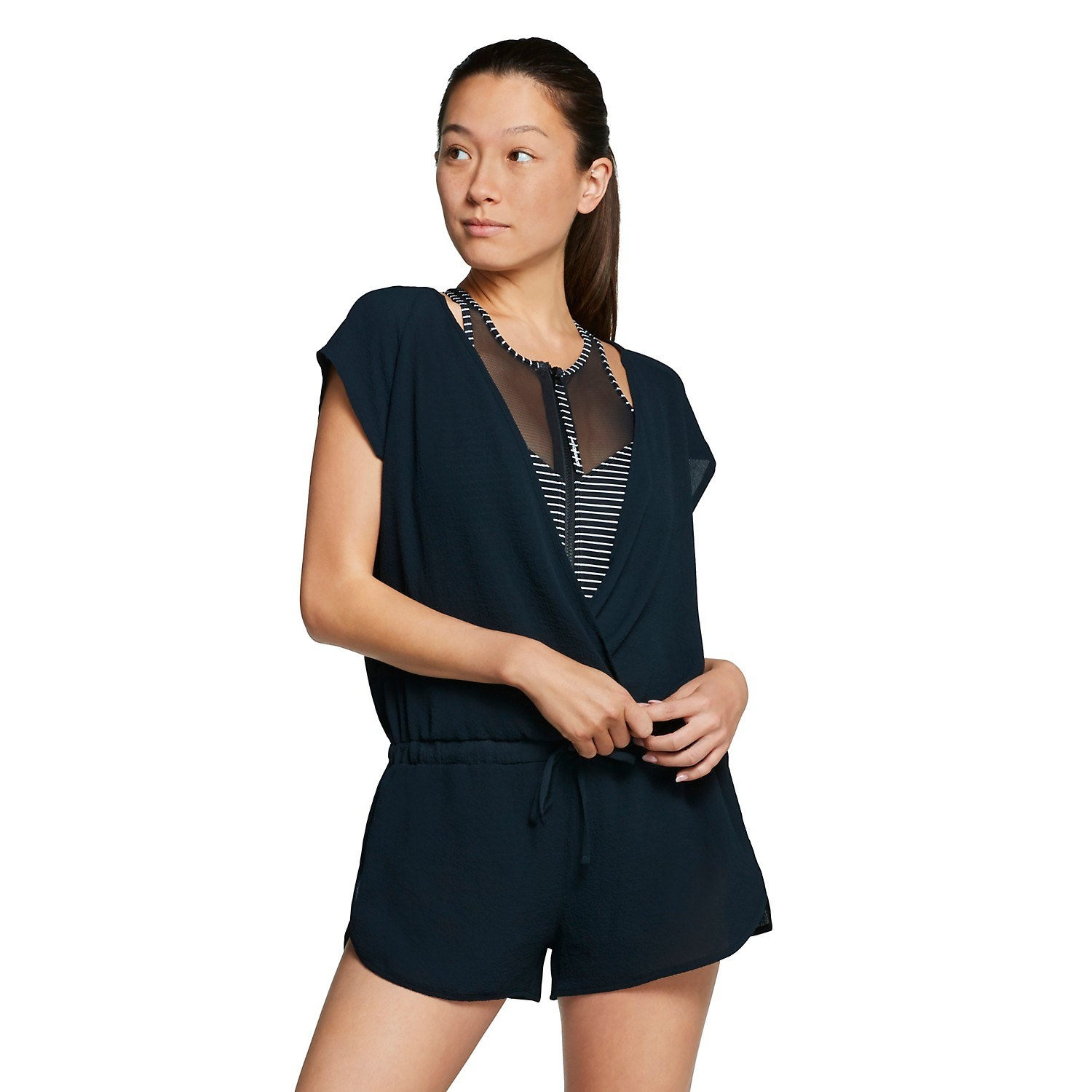Model wearing the drawstring-waist romper over a swimsuit