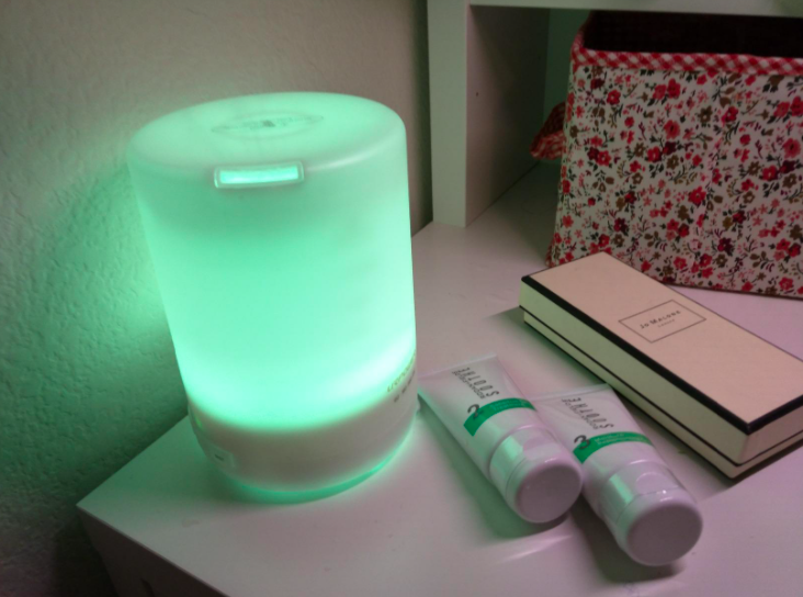 Minimalist white diffuser with green light on