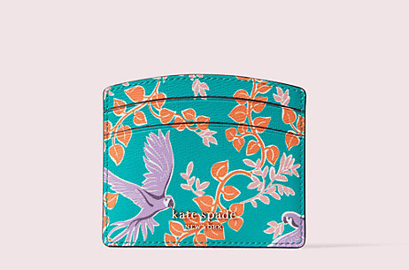 a turquoise card holder with purple parrots on it and orange and pink vines