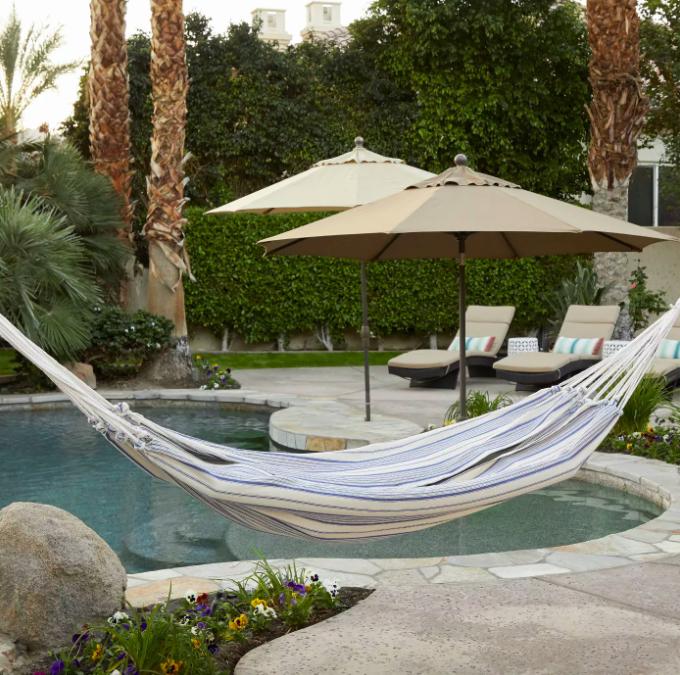 Linen blue striped hammock hanging poolside