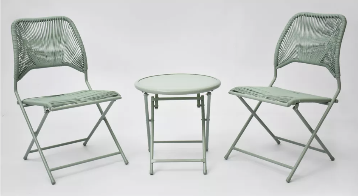 Two folding chairs and a folding table