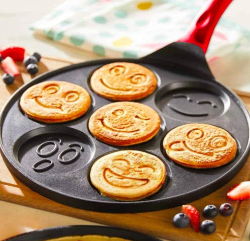 Emoji pancake griddle with smiley pancakes on a table