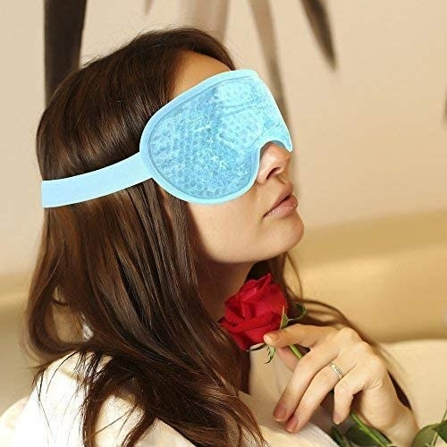 A person relaxes with the eye mask on