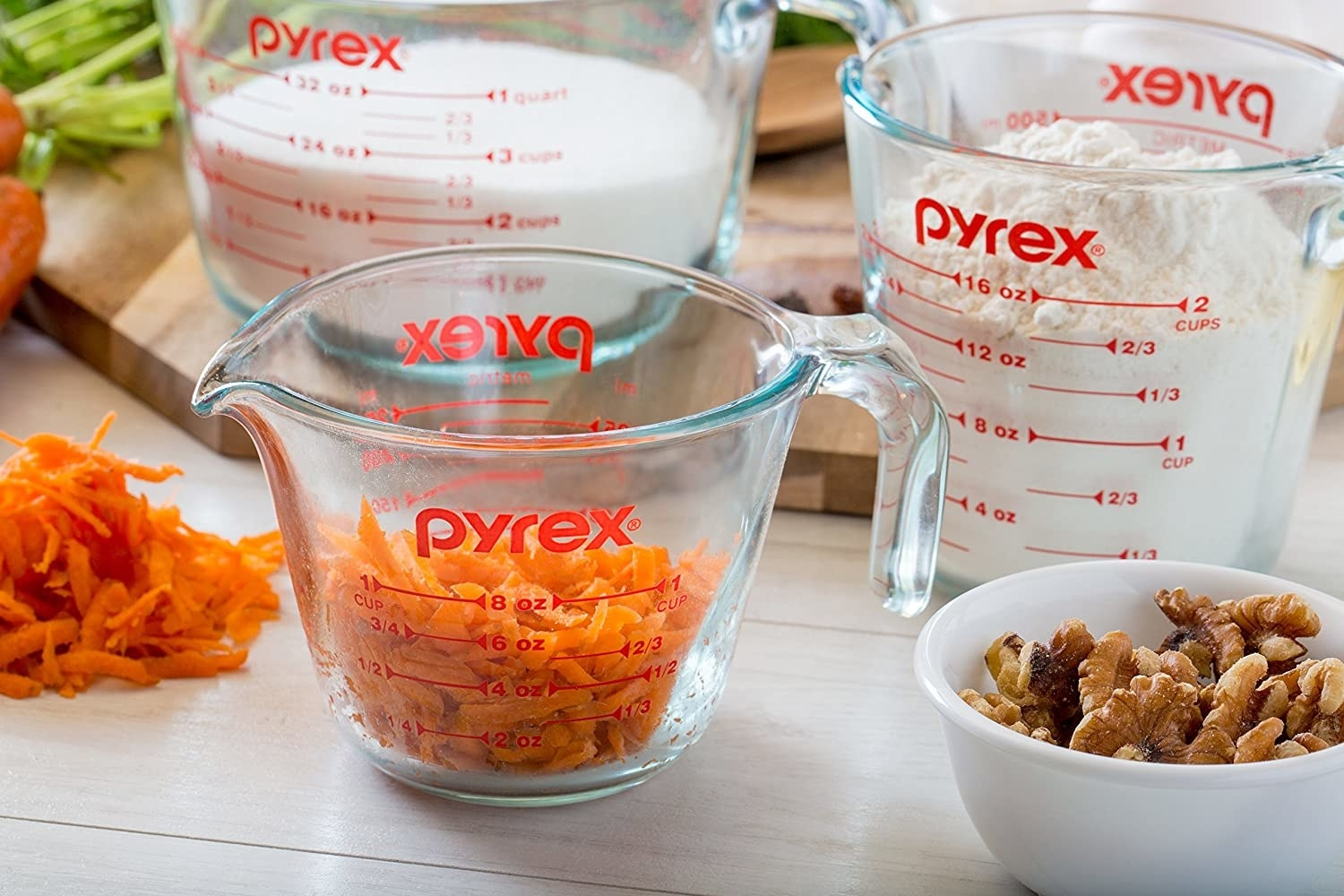 A 2-litre Pyrex measuring cup filled with sliced carrots