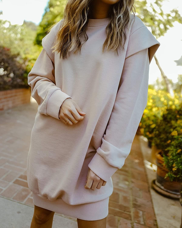 A model wearing The Drop Women's Rose Dust Power Shoulder Oversized Sweatshirt Dress.