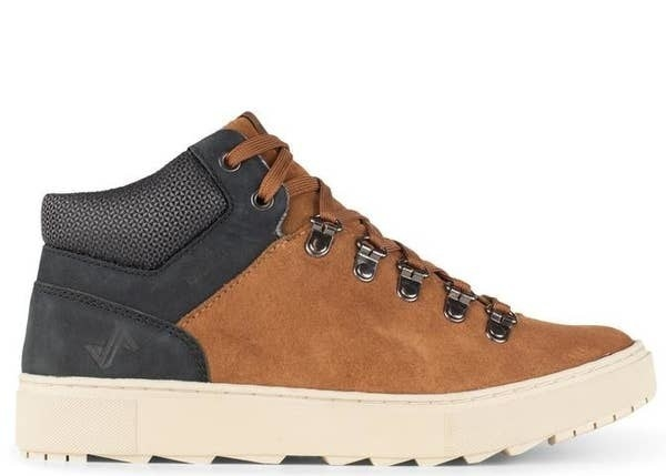 The shoe with brown suede body, black on the heel, extra cushioning on the heel, brown laces, and a white padded sole