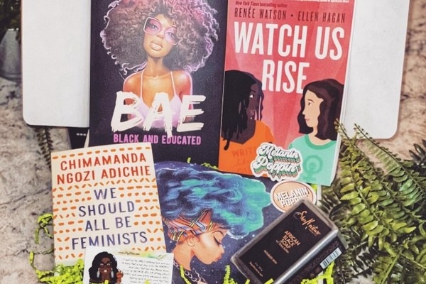An example of the books and products received in each monthly box