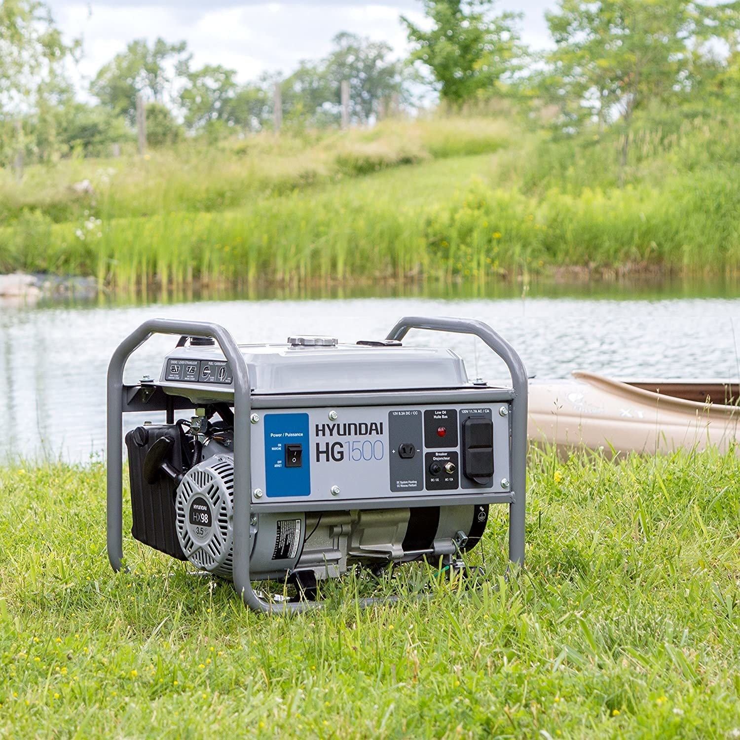 A Hyundai portable generator sitting on the grass next to a lake