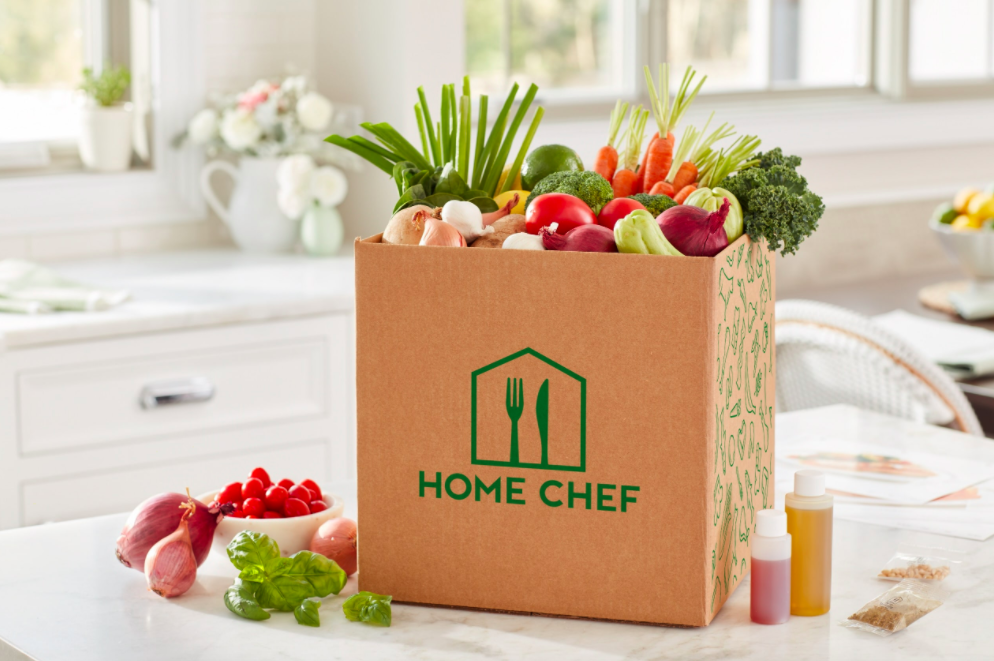 An unpacked HomeChef delivery box with fresh veggies