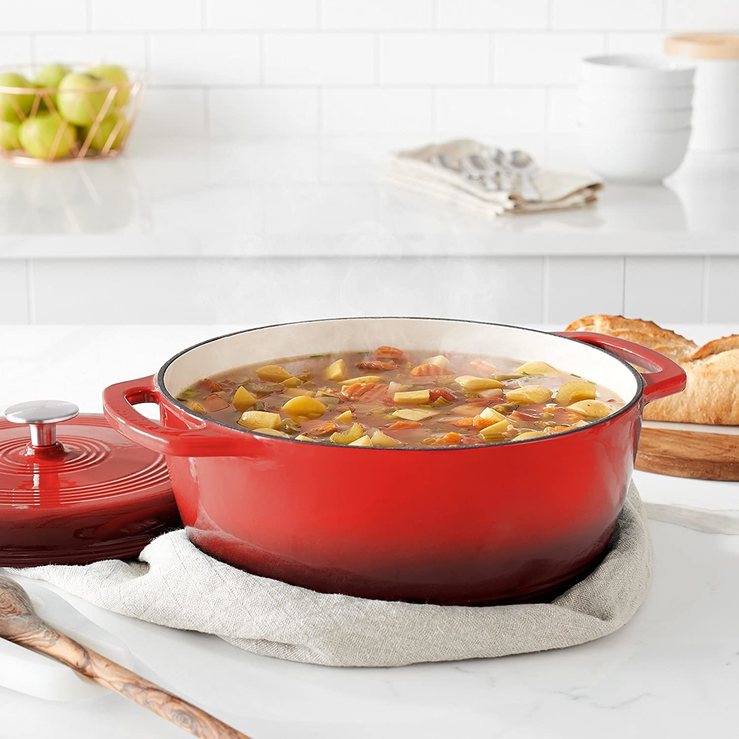 A dutch oven hold a full pot of stew