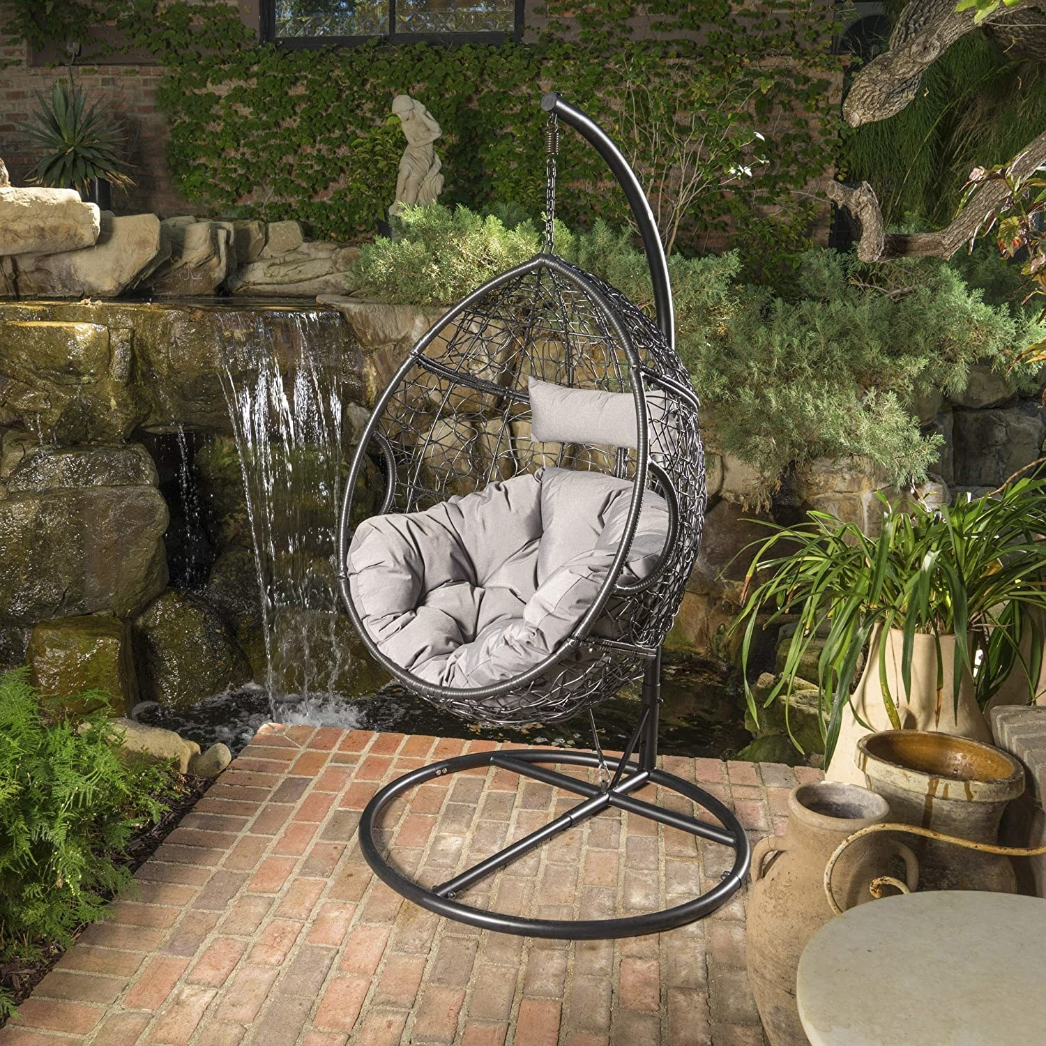 Oval-shaped swing chair with a cushion