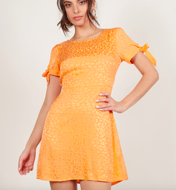 A model wearing the shift dress.