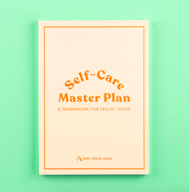 """The journal with the text """"Self-Care Master Plan"""" on the front"""