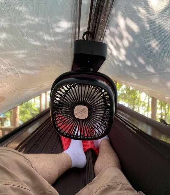 Reviewer's photo of the fan hung in their tent