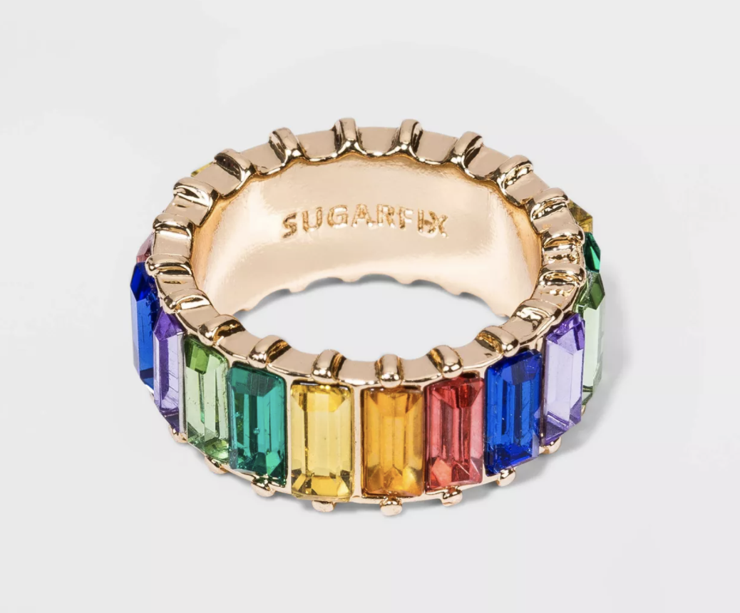 a thick band ring with a rainbow of stones around it