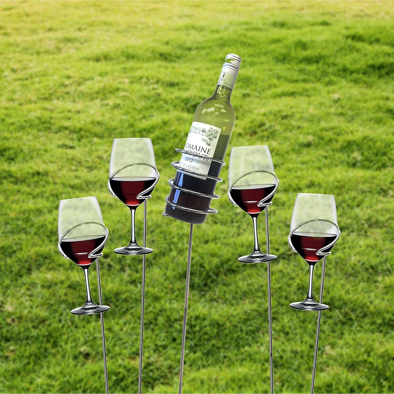 The wine sticks holding glasses and a wine bottle above the ground