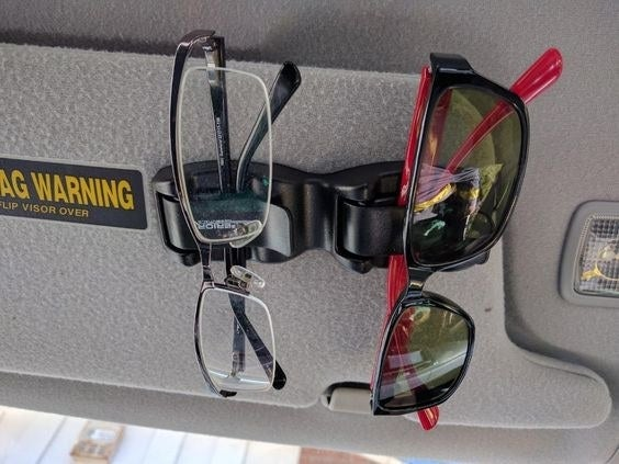 Reviewer's photo of their glasses and sunglasses attached to their sun visor