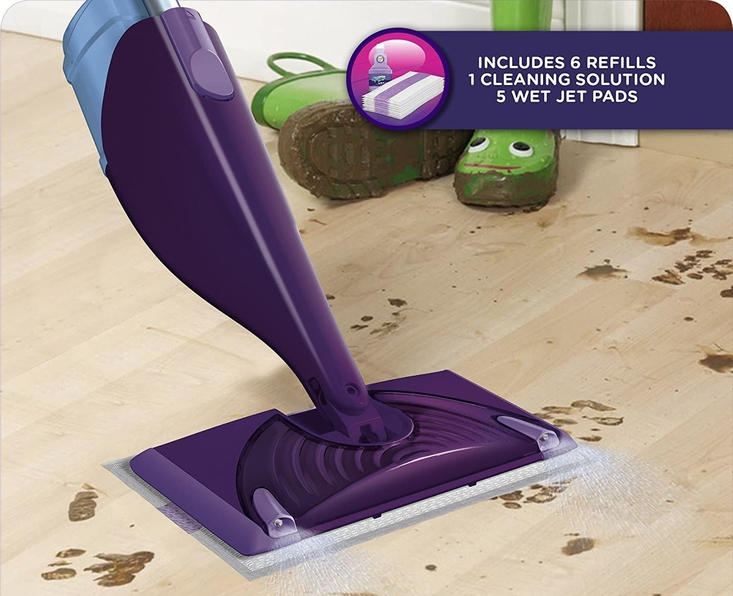 The WetJet being used to clean a floor filled with muddy paw prints