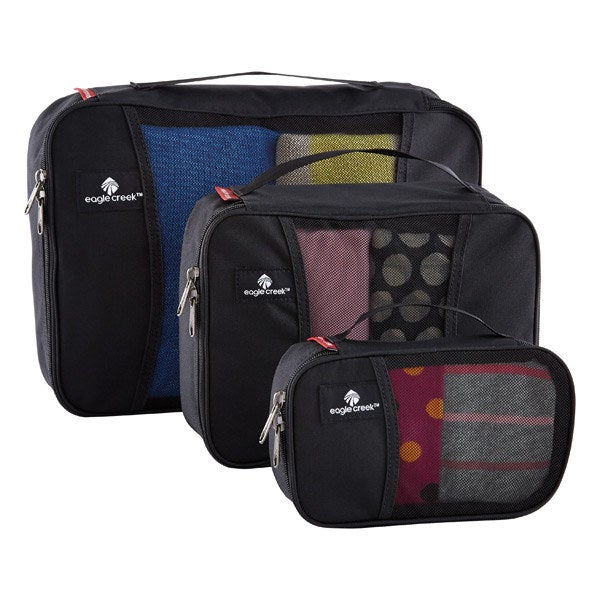 A three-pack of black travel cubes arranged in sizes ascending order filled with clothing