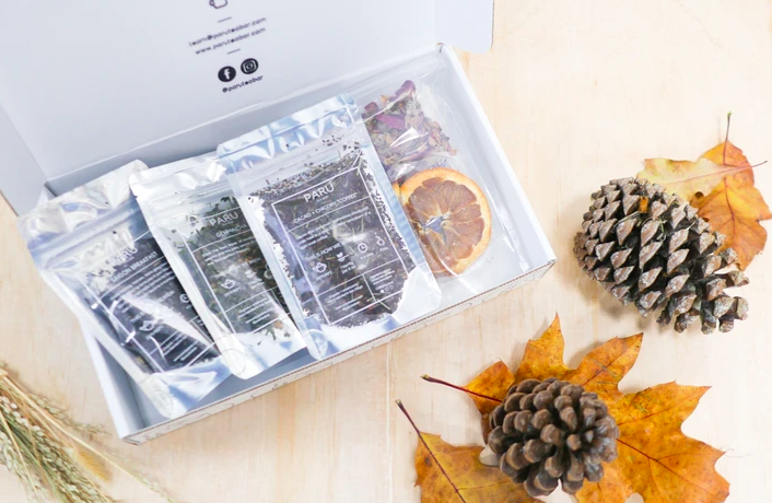 Three loose tea bags inside a Paru Tea Bar monthly subscription box