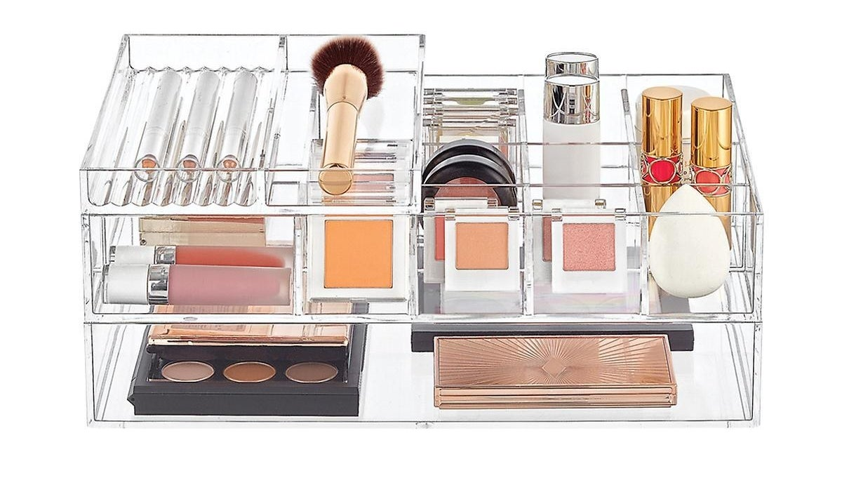 Various makeup supplies neatly organized in a see-through storage kit