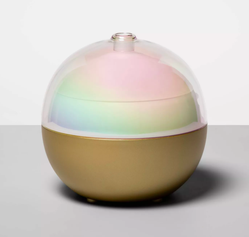 Orb-shaped diffuser with muted rainbow body and golden base
