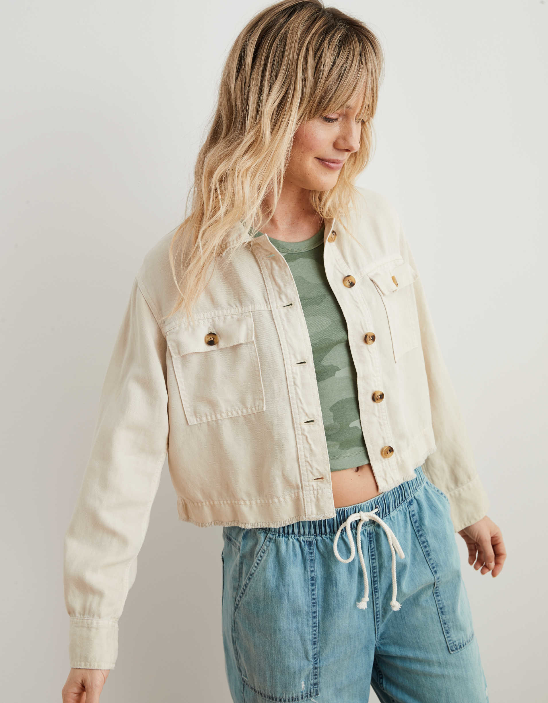 A model wears the empire cream Aerie twill cropped jacket
