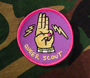 A pink and purple badge with embroidery that says