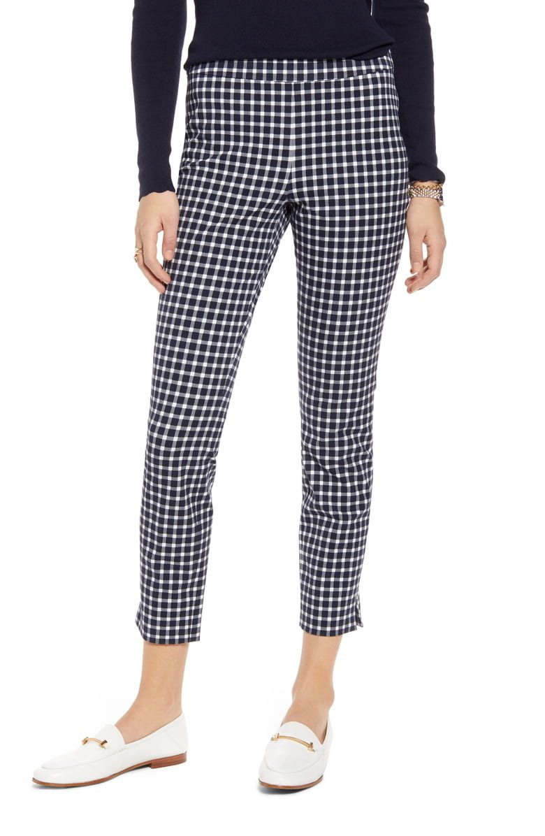 model wearing check print skinny stretch ankle pants with while mules
