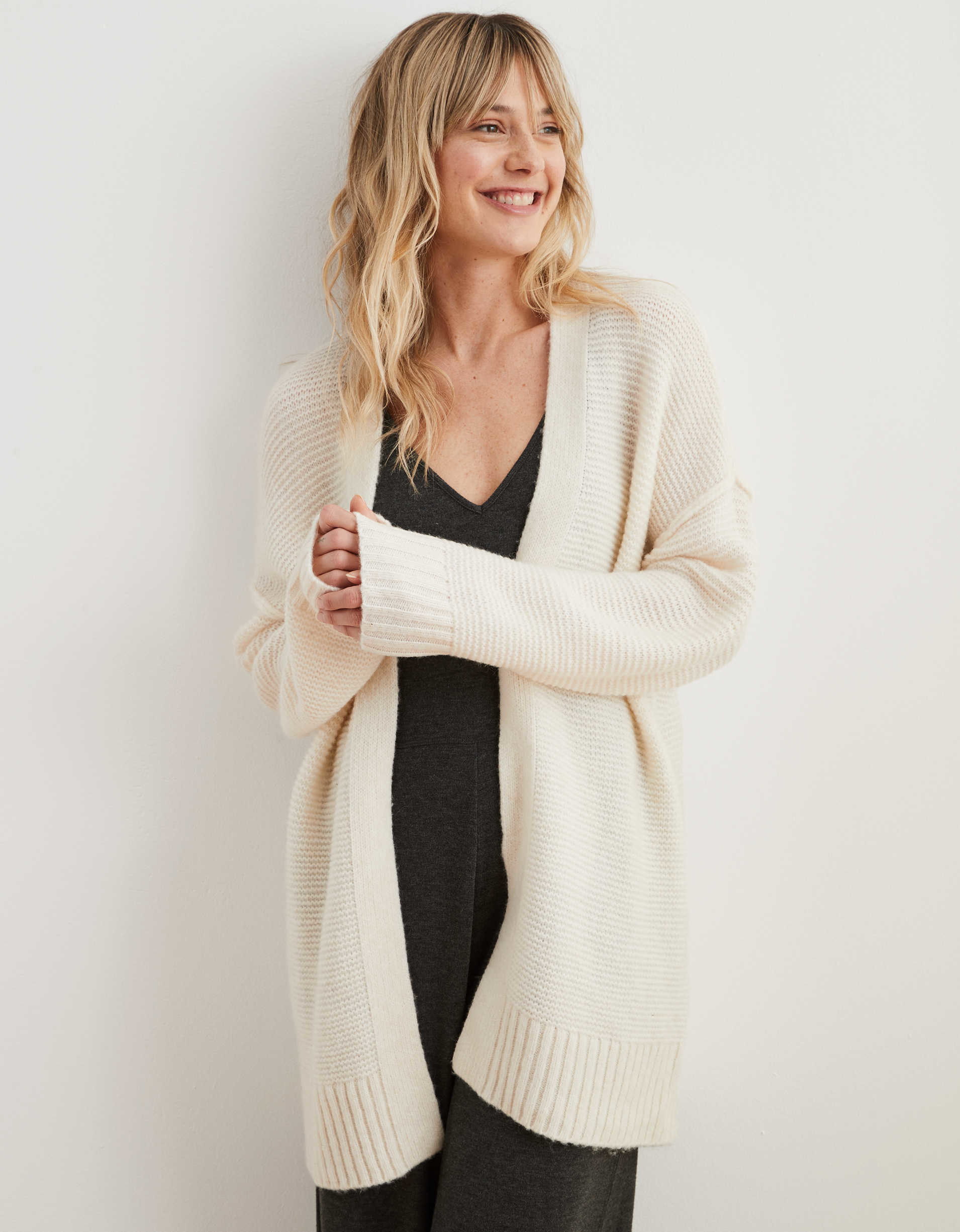 A model wears the Aerie Easy cardigan in the color natural