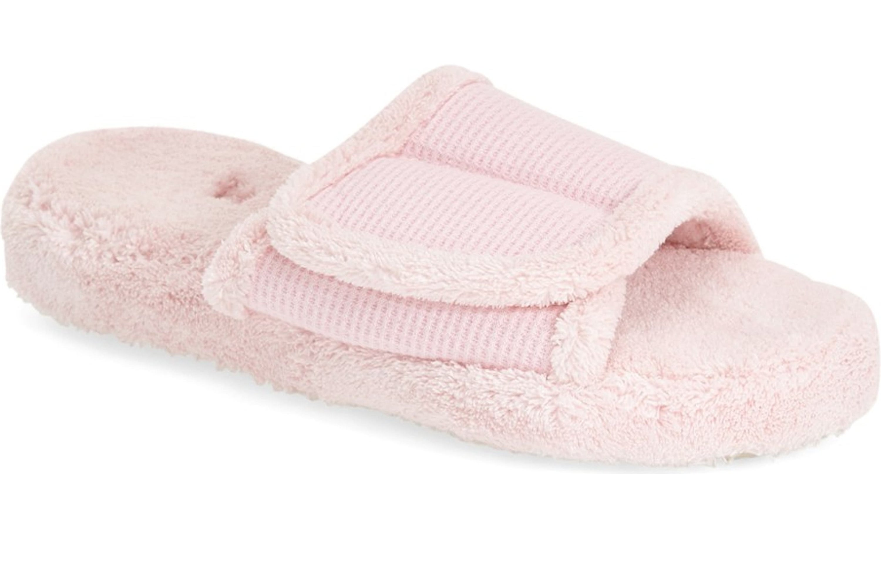 Pink cloth slip-on with a flap across the top that can be opened thanks to velcro