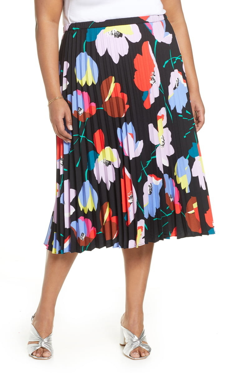 plus size model wearing black midi skirt with colorful pop art style floral pattern
