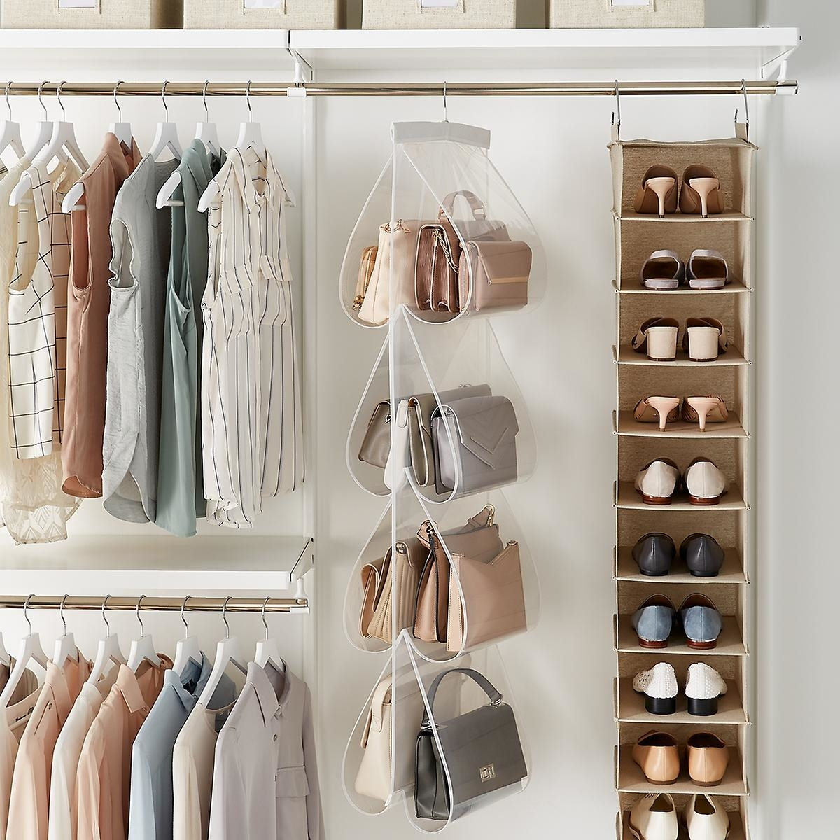 Multiple handbags hanging in the purse file inside a closet
