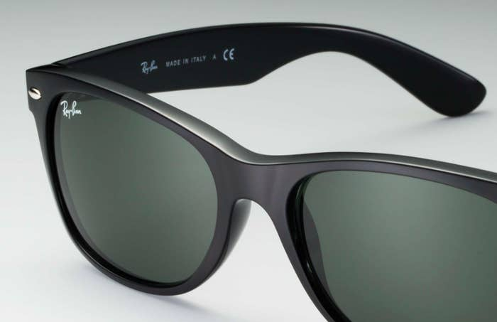 A close-up of plastic sunglass frames with glass lenses, etched with Ray-Ban signature logo