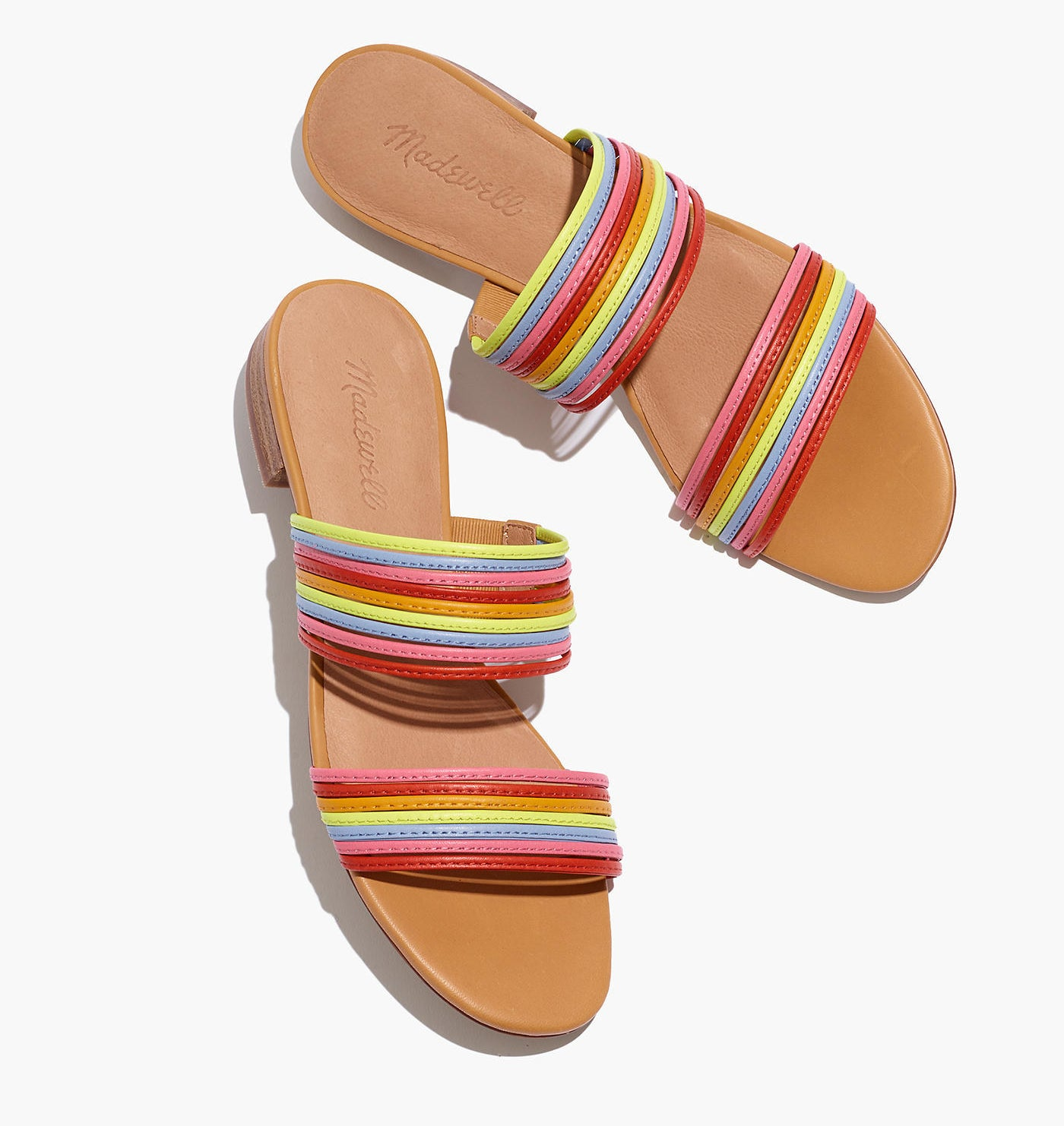 The slides with two sets of thin straps across the footbed in different rainbow colors