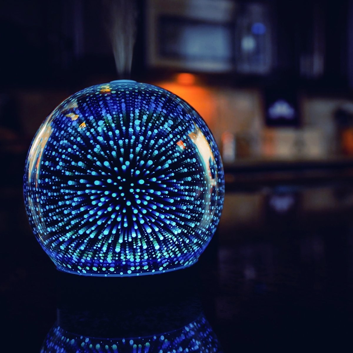 Orb-shaped diffuser with blue and green galaxy-style LED lights