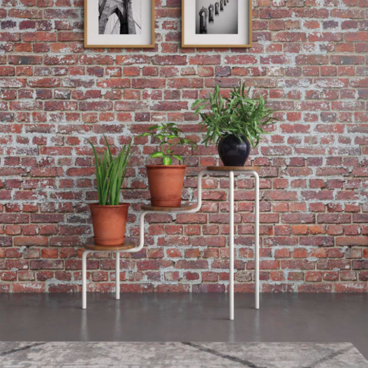 three tier plant stand with thin white legs and natural wood surfaces