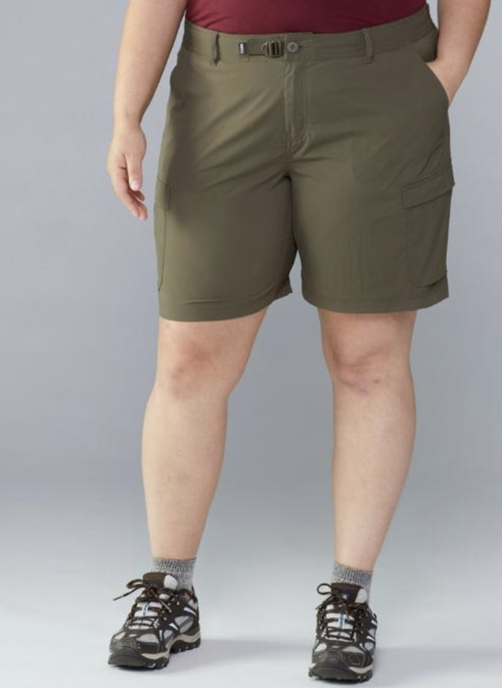 model in olive green  knee-length shorts with many pockets and an adjustable waist