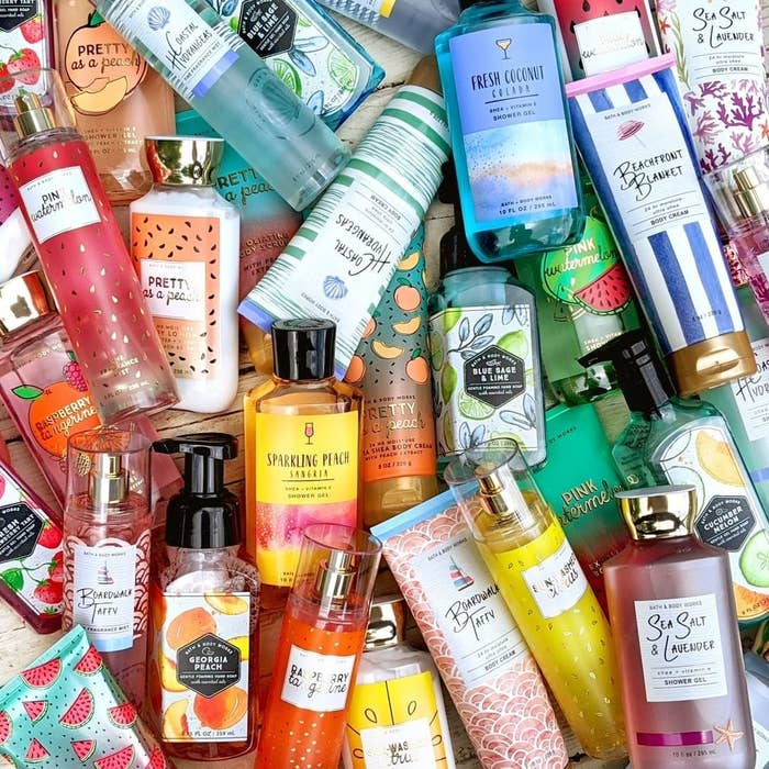 a pile of various bath and body works lotions, shower gels, and soaps