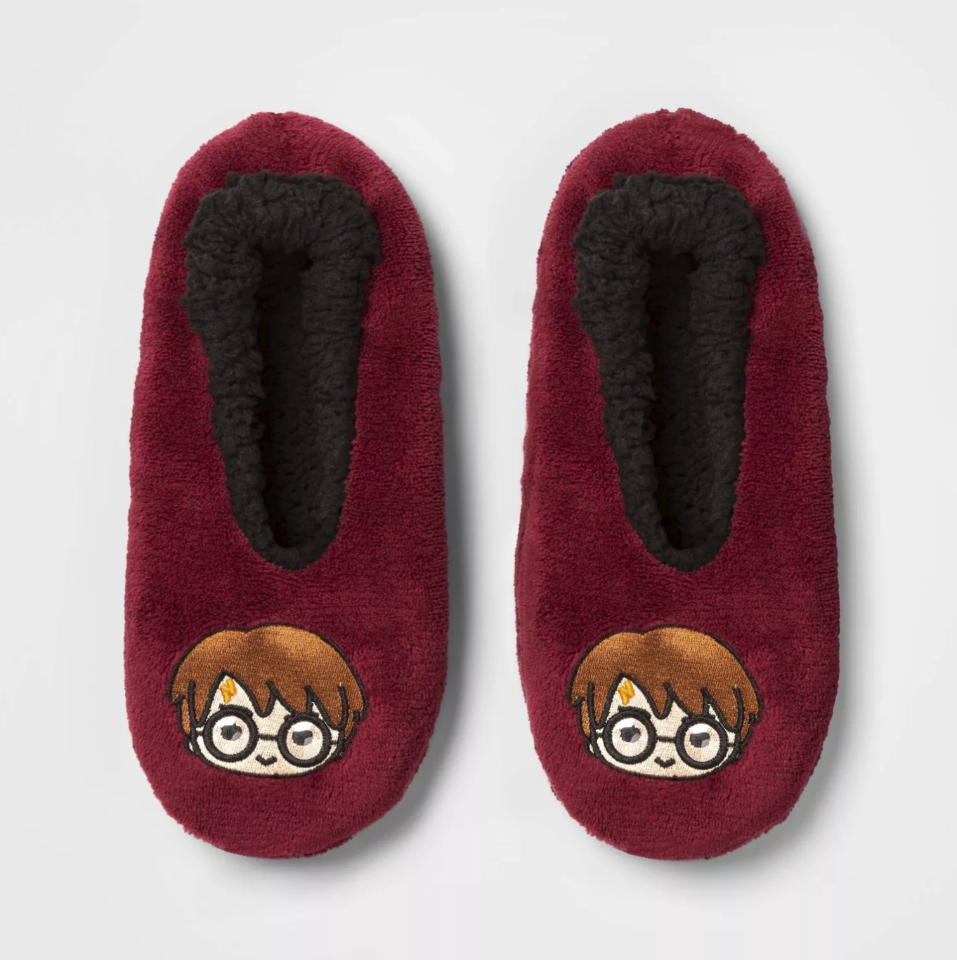 They're a deep red with animated Harry Potter heads across the toe. They look like socks but are thicker.