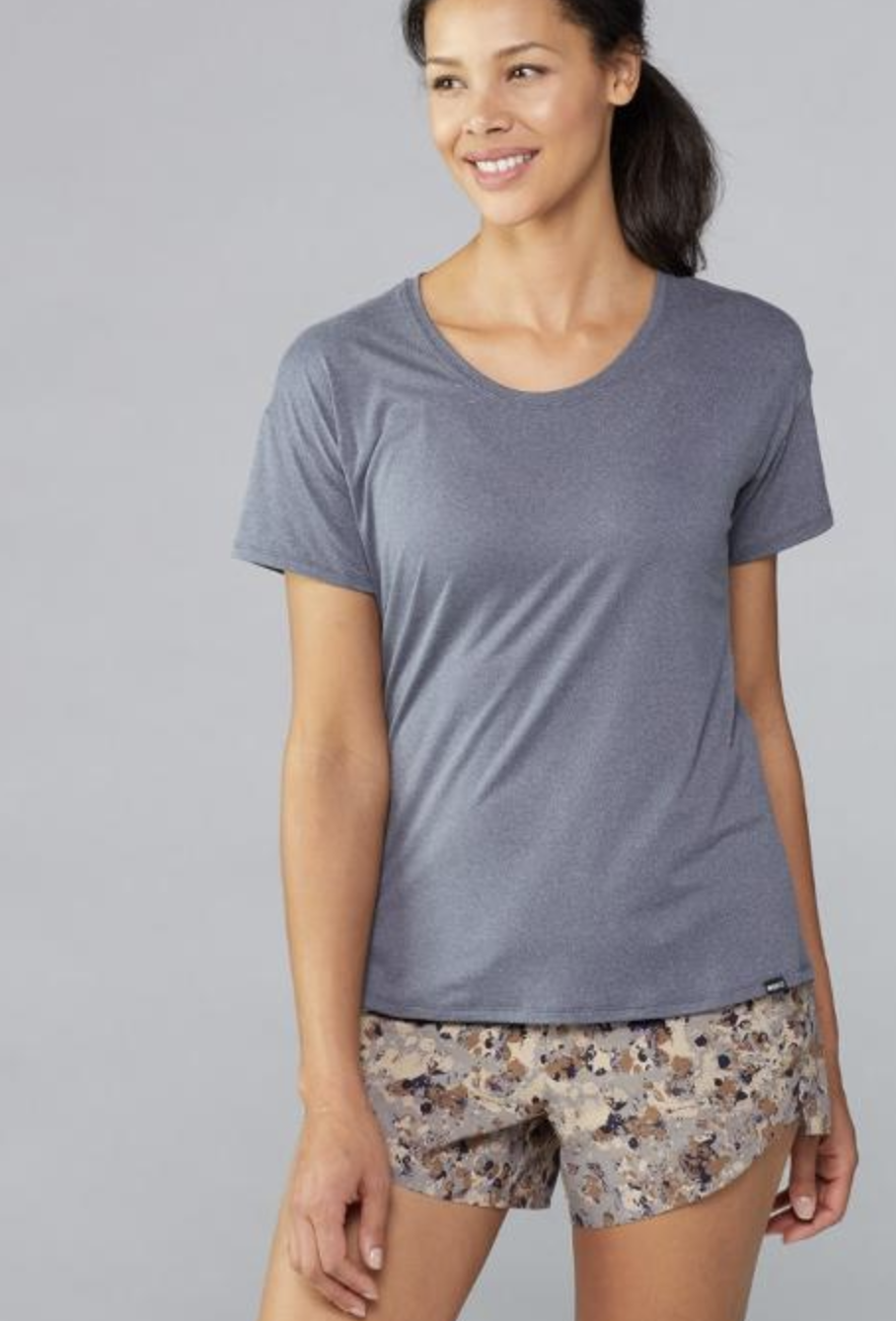 model in greyish blue round-neck tee