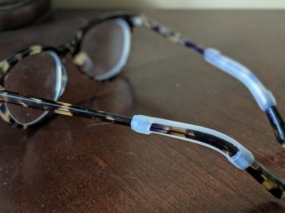 Reviewer's picture of the silicone grips attached to their glasses' ear hooks