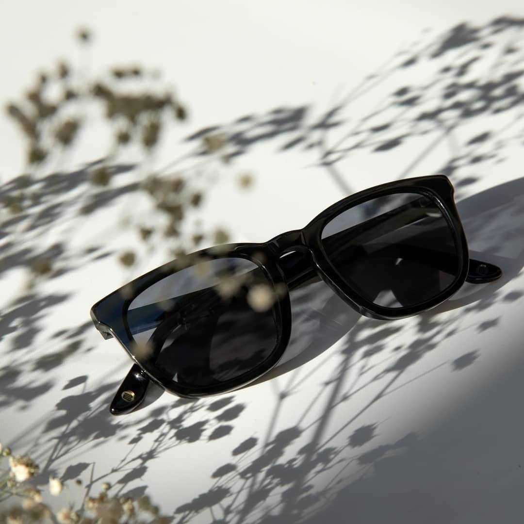 a pair of dark tortoise shell sunglasses