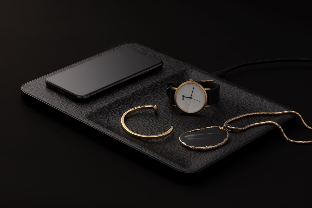 a black accessory tray that also works as a charger