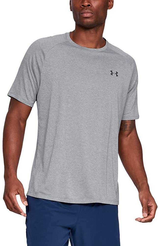model in grey tee with small under armour symbol