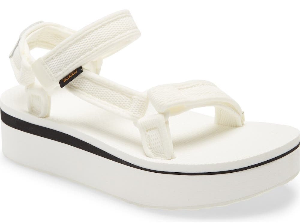 The flatforms with black stripe on the sole in white