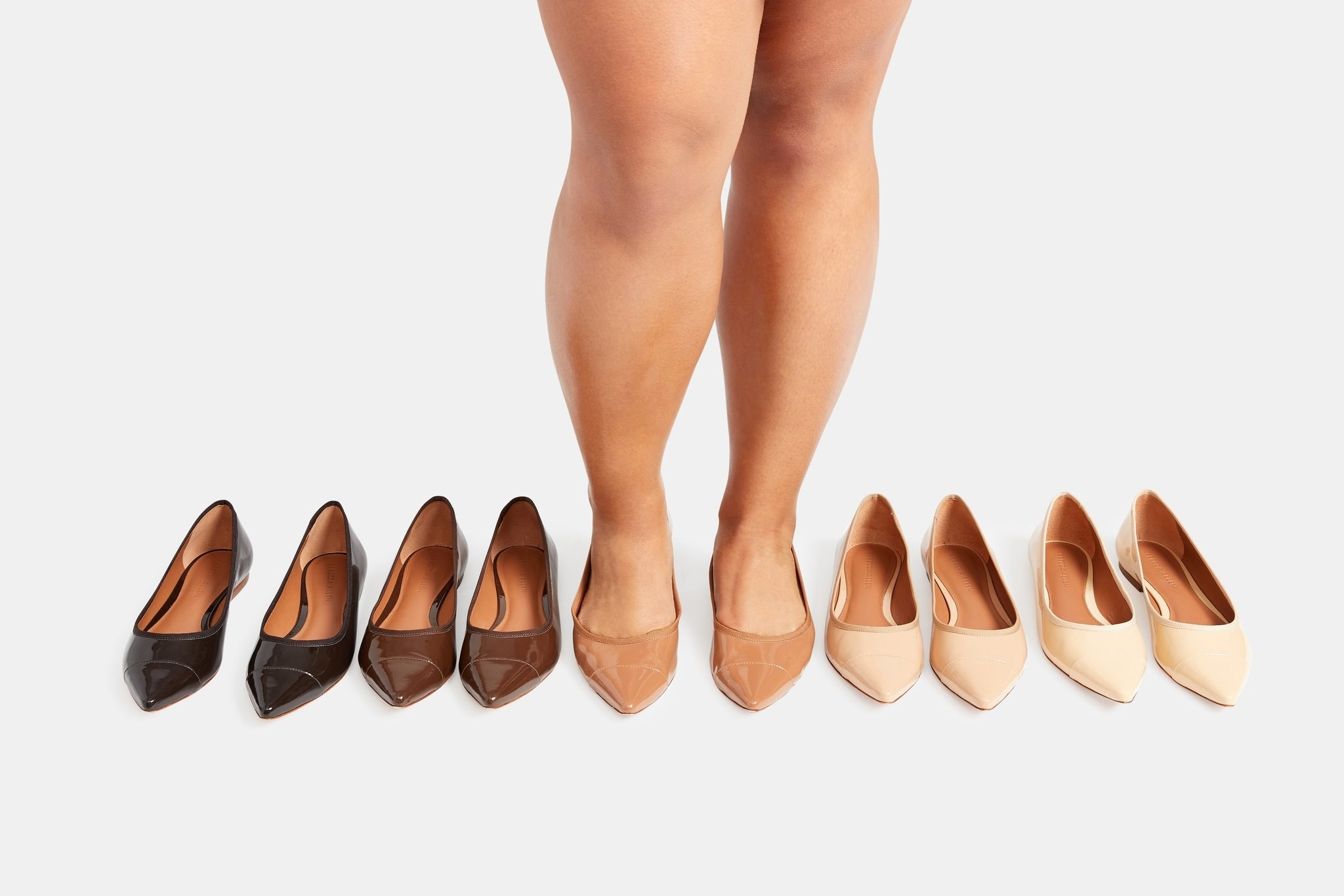Model wearing the middle of the five shades of shoe, with all five pictured
