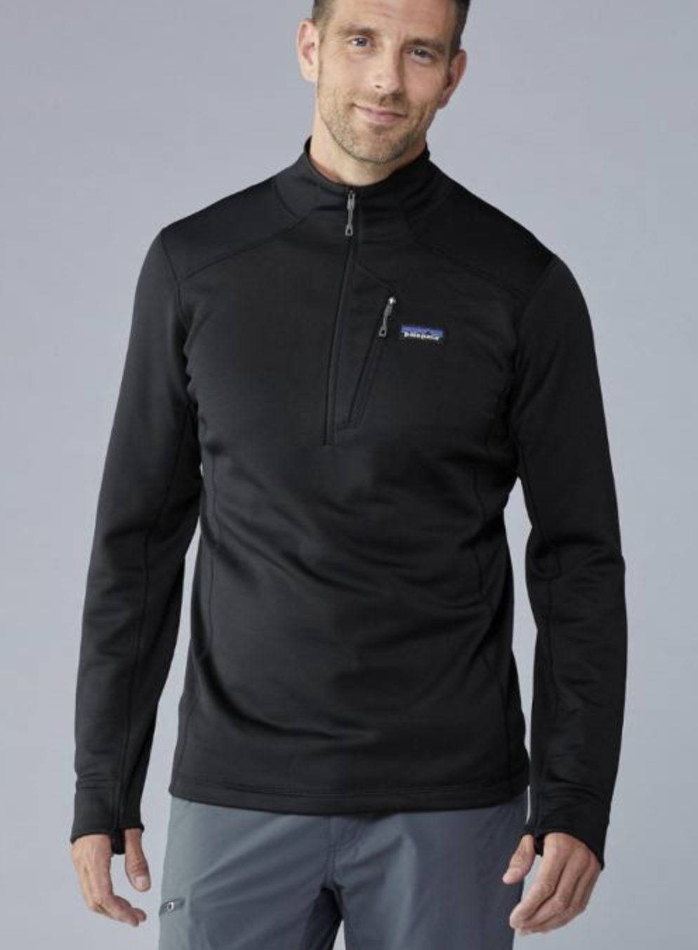 model in black long sleeve quarter-sip fleece